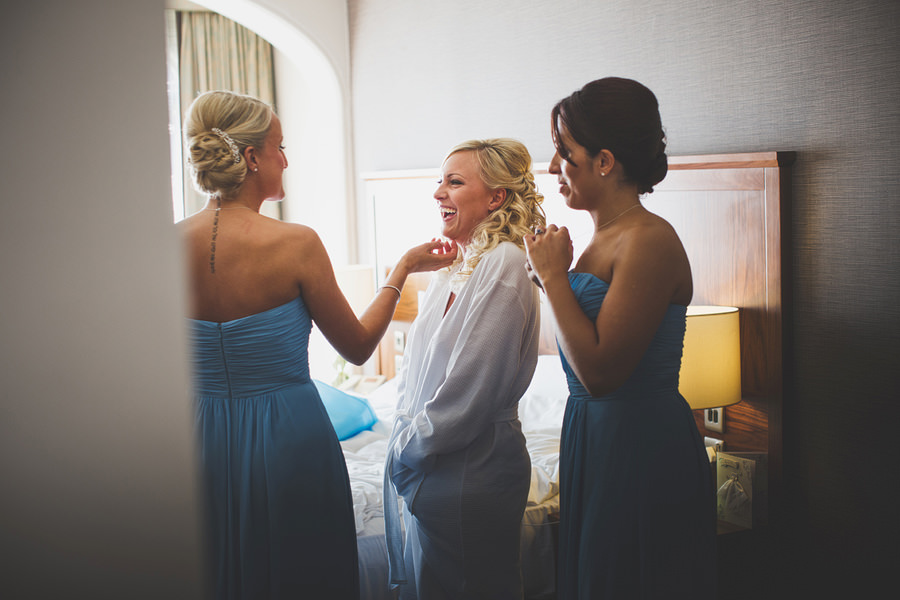bride-and-bridesmaids-laughing