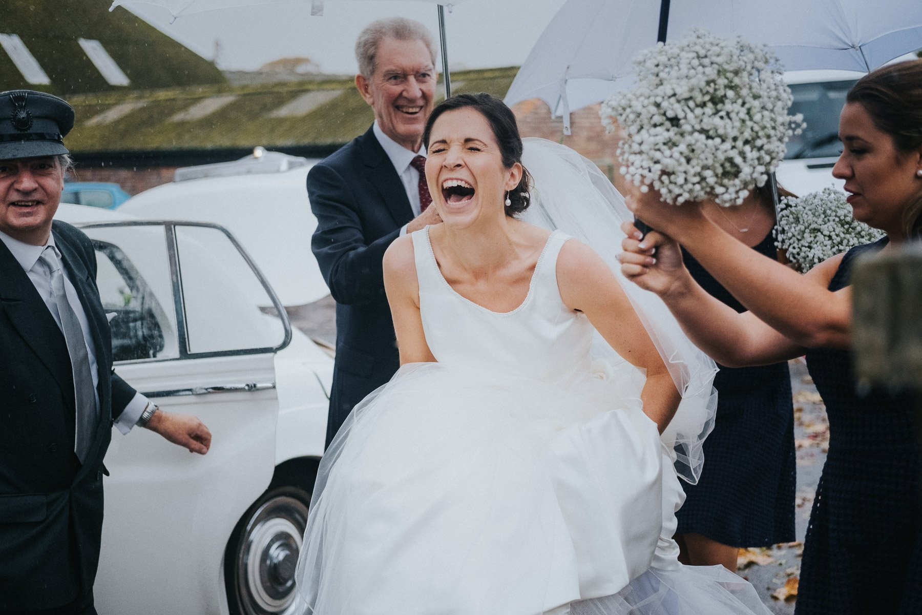 bride-laughing-during-rain